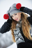 Beautiful young girl playing in the snow — Stock Photo