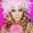 Portrait of the woman in pink feathers - Stock Photo