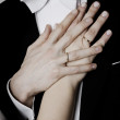 Stock Photo: Wedding rings on hand