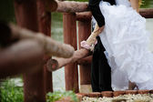 Wreathed hands with the ring on the finger of the happy couple — Stock Photo