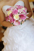 Bridal Bouquet in the bride hands — Stock Photo