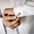 Man fastening clip sleeve white shirt — Stock Photo