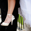The rate of the bride in a luxurious shoes — Stock Photo