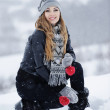 Beautiful girl in white snow — Stock Photo