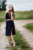 Beautiful young girl dressed fashionably — Stock Photo