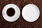 Empty saucer and cup of coffee — Stock Photo
