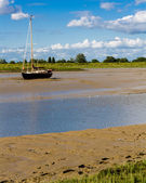 Sailboat moored in estuary — Stock Photo
