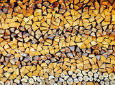 Stacked firewood background — Stock Photo