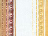 Pozadí abstraktní s pruhované tkaniny — Stock fotografie