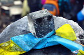 Ukrainian flag pressed to a stone — Stock Photo