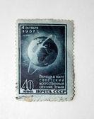 Sello de correos retro con el primer sputnik — Foto de Stock