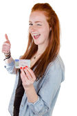 Young woman showing her driver's license — Stock Photo
