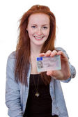 Young woman showing her driver's license — Stockfoto