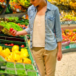 Young woman in the supermarket — Stock Photo #18988029