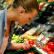 Stock Photo: Young woman in the supermarket