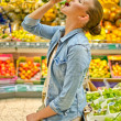 Young woman in the supermarket — Stock Photo #18988897
