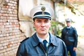 Police officer is looking into camera — Stock Photo