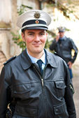 Police officer is looking into camera — Stockfoto