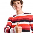 Royalty-Free Stock Photo: Portrait of a handsome young man, with a thumb up gesture