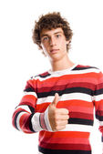 Portrait of a handsome young man, with a thumb up gesture — Stock Photo