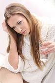 Young woman with glass of water — Stock Photo