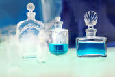 Perfume on the green table — Stock Photo