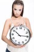 Chica con un reloj sobre fondo blanco — Foto de Stock