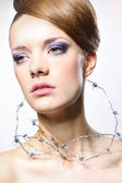 Young woman with barbed wire around her throat. Сoncept — Foto Stock