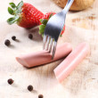 Strawberries and sausages, chop the plug — Stock Photo