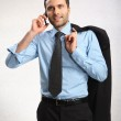 Portrait of young business man using cell phone — Stock Photo