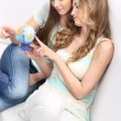 Stock Photo: Mother and daughter looking at a globe