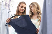 Two pretty girls choosing clothes — Stock Photo
