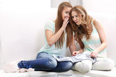Blonde girls whispering — Stock Photo