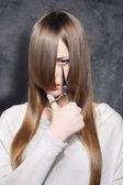 Girl with scissors — Stock Photo