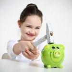 Little girl breaking piggy bank — Stock Photo #21737249