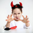 Cute little girl in imp suit — Stock Photo #21737813