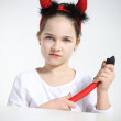 Little girl in imp suit — Stock Photo #21737855