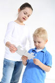 Sister and brother play with puzzle pieces — Stock Photo