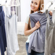 Stock Photo: Pretty girl trying on clothes