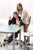 Two girls near the glass table — Stock Photo