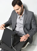 Young businessman working on is laptop — Stock Photo