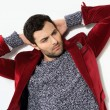 Handsome man posing in a red jacket — Stock fotografie