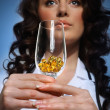 Doctor holding a glass with pills — Stock Photo #23564119