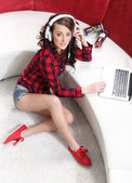 Beautiful girl with a computer — Stock Photo