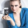 Fashion woman holding a vintage camera — Stock Photo #24438955