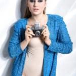 Fashion woman holding a vintage camera — Stock Photo