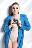 Fashion woman holding a vintage camera — Stock Photo