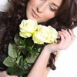 Photo of beautiful woman with white roses - Stock Photo