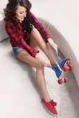 Young woman dress roller-skates — Stock Photo