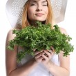 Woman with green salad leaves — Stock Photo